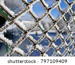 Snow On Iron Fence And Winter...