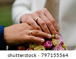 wedding rings on the hands of... | Shutterstock . vector #797155564