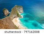 Small photo of View of the beach Kelingking from a high cliff.Travel destination in Bali. Popular place to visit on Nusa Penida island.Energy of the ocean.The most beautiful places of Indonesia.Places of power