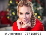 beautiful girl by the fireplace | Shutterstock . vector #797168938
