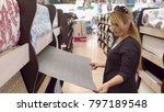 girl chooses wallpaper in the... | Shutterstock . vector #797189548