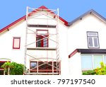 Small photo of Outside home painting, before and after, and scaffold tower