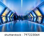 Small photo of Crossrail with blurred people walking, Canary Wharf, London, United Kingdom