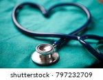 a stethoscope shaping a heart... | Shutterstock . vector #797232709