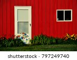 Side Of A Red Barn With White...