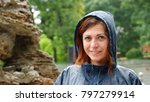 a smiling girl in a raincoat... | Shutterstock . vector #797279914