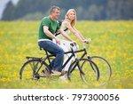 couple riding bikes | Shutterstock . vector #797300056