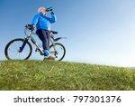 senior man drinking water on... | Shutterstock . vector #797301376