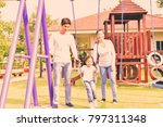 at the park  parents are... | Shutterstock . vector #797311348