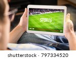 Small photo of Man watching sports on tablet. Football and soccer game live stream and video player on screen. Pay per view (PPV) service. Replay or highlights broadcast. Lazy person relaxing. Couch potato.