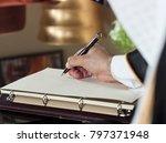saudi arabian man hand writing... | Shutterstock . vector #797371948