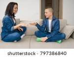 happy mother and son sitting on ... | Shutterstock . vector #797386840