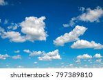 Blue Sky With Fluffy Clouds As...