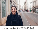 Small photo of Female traveler woman walking streets of European capital.Visitor in Lisbon,Portugal.Traveling Europe on a budget.Studying abroad.Student discount for traveling concept
