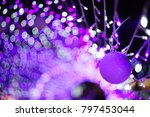 Small photo of Bokeh lighting background from light blue, purple, white, with blurred and ultraviolet bokeh perfect for Christmas or New Year accompanying festivals.
