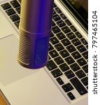 Small photo of Podcast Microphone above laptop keyboard ready to record media business creative spoken word