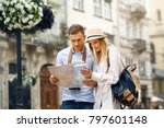 tourist couple with map walking ... | Shutterstock . vector #797601148