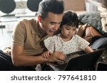 happy asian father looking at... | Shutterstock . vector #797641810