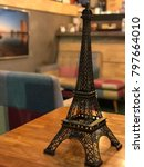 model eiffel tower on the table | Shutterstock . vector #797664010