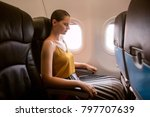 woman in plane suffer from... | Shutterstock . vector #797707639
