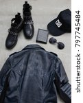 Small photo of Set of man black leather punk jacket with punk shoes,hat,sunglasses
