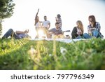 group of friends having pic nic ... | Shutterstock . vector #797796349