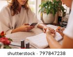 woman using mobile phone in... | Shutterstock . vector #797847238