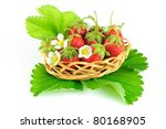 strawberries in basket with leaves and flowers - stock photo