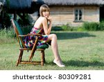 beautiful girl sitting in an... | Shutterstock . vector #80309281