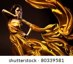 slim sexy woman in yellow fabric - stock photo
