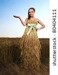 Woman In Wheat Field Under Blu...