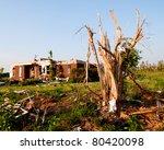 Tornado Damaged Land And Home...