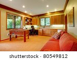 Guest house living room with red sofa - stock photo