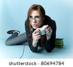 Teen model holding video game controller lying on floor - stock photo