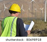 Engineer inspecting Site/Project Manager at the Wind Farm/Man working in the enviromental - stock photo