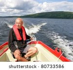 Man in a motor boat - stock photo