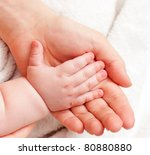 mother holding her child's hand | Shutterstock . vector #80880880