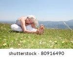 Senior Woman Doing Stretching...