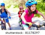 A Little Girl Riding Her Bike...