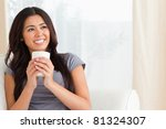 smiling woman holding a cup... | Shutterstock . vector #81324307