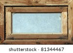 small dirty wooden window in wooden wall of byre - stock photo