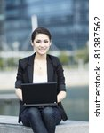 Asian Business woman using a Laptop outside - stock photo
