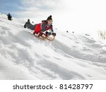 Pre Teen Boy On A Sled In The...