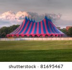 big top circus tent on a field in a park, built up for a music festival - stock photo