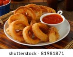A Plate Of Onion Rings With...