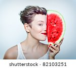 young beauty woman holding watermelon in her hand - stock photo