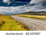 Landscape With Dirt Road In Th...