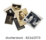 A group of old family photos and negatives on white background. - stock photo