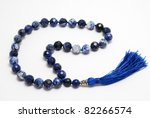 Blue Rosary Beads, from gem on white background - stock photo