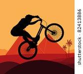 Animated mountain bike trial rider in Egypt pyramid ruin landscape illustration - stock vector